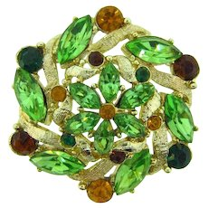 Vintage gold tone rhinestone Brooch in shades of green and topaz
