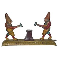 Old German Tin Penny Toy Gnomes Chopping Wood