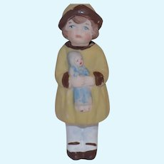 German Bisque Nodder Doll Girl Holding Doll