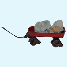 Antique Rubber Baby Doll Metal Tin Wagon