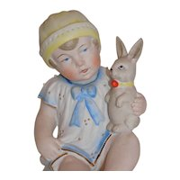 Antique German Piano Baby Doll Holding Rabbit Bunny Molded Bonnet