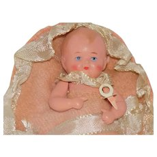 Old German Celluloid Baby Doll with Pacifier and Bunting
