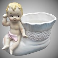 Baby Figurine Sitting on a Vintage Baby Bootee Vase Planter