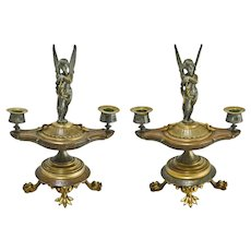 Pair Antique Figural Patinated Bronze Two Light Candelabra / Candlesticks / Candleholders with Winged Cupid on Classical Oil Lamp Shaped Base and Paw Feet - 19th Century, France