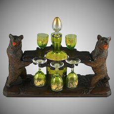 Antique Black Forest Carved Wood Liquor Tantalus, Stand   Pair of Twin Bears   Hand Painted Raised Enamel Decanter & Cordial Glasses Set