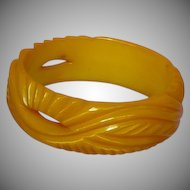Heavily Carved and Pierced  Butterscotch Vintage Bakelite Bangle Bracelet