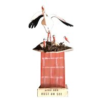 Storks on the Roof - A Souvenir from Austria