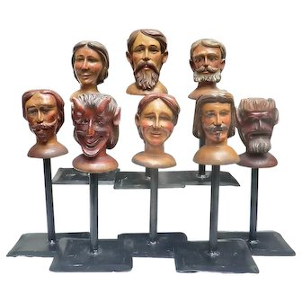 Set of 8  Carved Wooden Puppet Heads on Display Stands