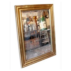 Parisian Brass Framed Mirror with Mercury Glass from a Late 19th Century Brasserie or Bistro.