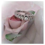 14 Karat White Gold Ring with Seven Diamonds