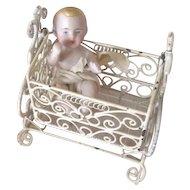 All Bisque Antique Baby in Vintage Metal Cradle
