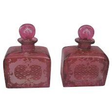 Fabulous Antique Pair of Cranberry Colored Glass Perfume Bottles with Etched Motif