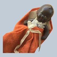 Hertwig  German Painted Bisque Brown/Black Baby in Bunting Circa 1910