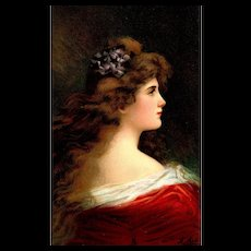 Vintage valentines day postcard of  a young beautiful woman
