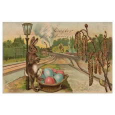 1908 Cool Easter Bunny Rabbit waits for the train to deliver his eggs Vintage postcard