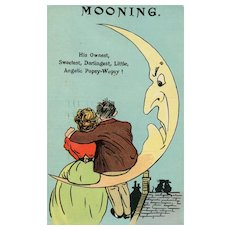 "1912  Romantic couple sits on a crescent moon ""Mooning"" postcard"