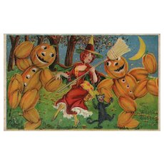 The Witches Dance Witch dances with pumpkin Men and a black cat vintage Postcard