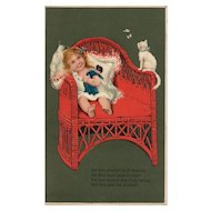 Adorable and colorful Little girl on red wicker Chair with her Doll and White Kitten PFB Vintage postcard