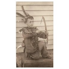 Early 1900's Real Photo Boy Dressed up in Indian Costume with Bow Arrow Feathers