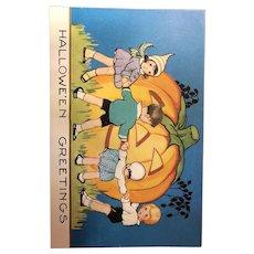 Halloween postcard Whitney WH20-1 Children around pumpkin JOL Vintage