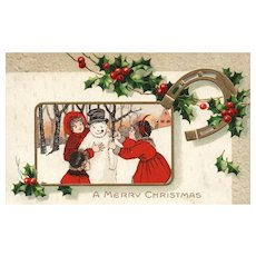 1911 Children build a snowman Vintage Christmas postcard horseshoe luck
