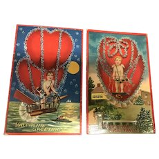 Pair of colorful Vintage Valentine Postcards Cupid travels by Balloon Moon