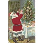 Santa Claus Red Robe Decorating Christmas Tree Silk Embossed Postcard