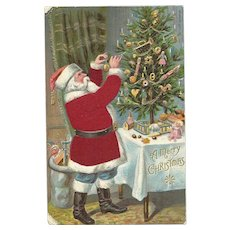 Santa Claus Red Robe Decorating Christmas Tree Silk Embossed Postcard