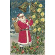 Red Robed Santa Claus Bells Candle Lit Christmas Tree Holly Silk Embossed Postcard
