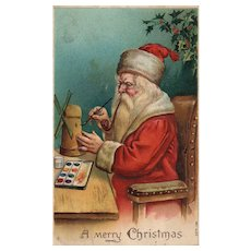 Santa Claus in his workshop painting a windmill Series 156 Vintage Christmas postcard