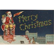 AMB Santa Claus writes a Merry Christmas Greeting in the night sky