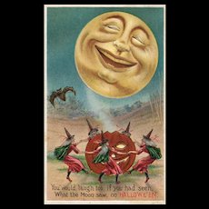Fantastic vintage Halloween postcard featuring a large Full Smiling moon with dancing witches