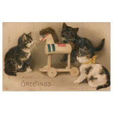 3 Kittens Cats playing with a wooden toy horse Cat Vintage Postcard