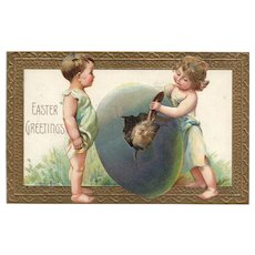 Easter Greetings Adorable children assist in a hatching egg with a bunny rabbit inside  Postcard