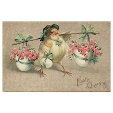Unsigned Ellen Clapsaddle Easter Chick carrying eggs with flowers vintage postcard