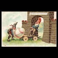 Early Fantasy Easter Gnomes transporting an egg via a cart / wagon postcard