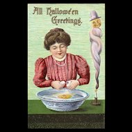 Vintage Halloween Postcard Woman cracking egg in bowl of water Voo Doo Dark Magic Spell