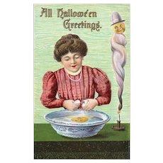 Vintage Halloween Postcard Woman cracking egg in bowl of water Voo Doo Dark Magic Spell
