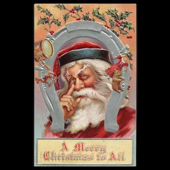 1909 Santa Claus lays a finger aside of his nose Horse shoe Vintage Christmas postcard