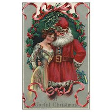 1912 Santa Claus with a  beautiful Victorian woman vintage Christmas postcard
