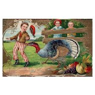 Absolutely gorgeous gold gilt Gel boy Thanksgiving Turkey Postcard Samson Brothers