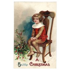 Embossed Boy Sitting On Chair Next To Bouquet Of Holly Ellen H Clapsaddle Christmas Postcard