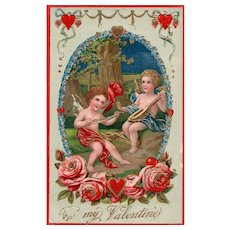 Gold Gilt Gel Cupids playing music and preparing to shoot some arrows Vintage Valentine Postcard