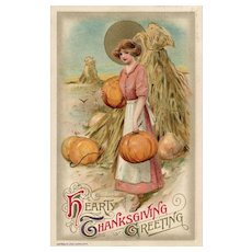 1910 John Winsch Samuel Schmucker  Gold Metallic Sun Woman Holding Pumpkins In front Of Cornstalks Thanksgiving Postcard