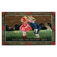 Boy & Girl kissing Samson Brothers 7040 Gold Gilt Gel vintage Valentine postcard