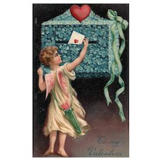 1909 To My Valentine Cupid Mails a letter in a Forget Me Not Floral Box PFB 7584