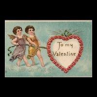 To My Valentine Cupids pulling heart Embossed gold gilt Vintage Valentine postcard