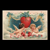 Beautiful vintage Valentine featuring Two Cupids resting on a cloud under a heart
