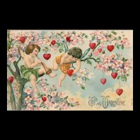 "Scarce To My Valentine Cupids ""hanging out"" in a tree Play horn Vintage Valentine Postcard Series 702"