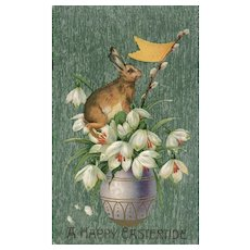 A Happy Eastertide Bunny Rabbit on Easter Egg with Lilly's vintage postcard